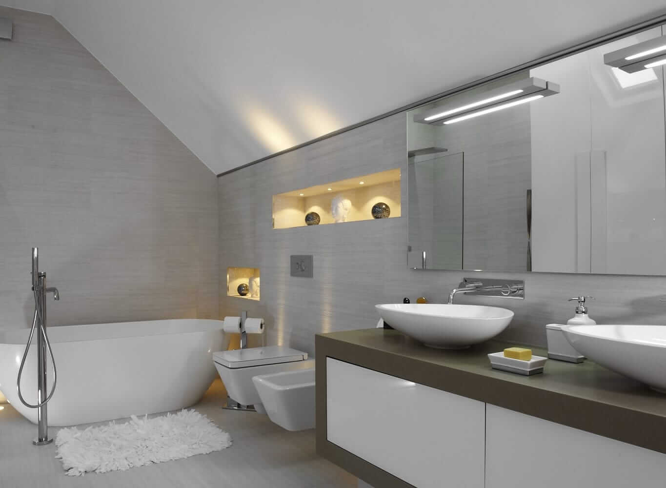 bathroom with a toilet and sinks