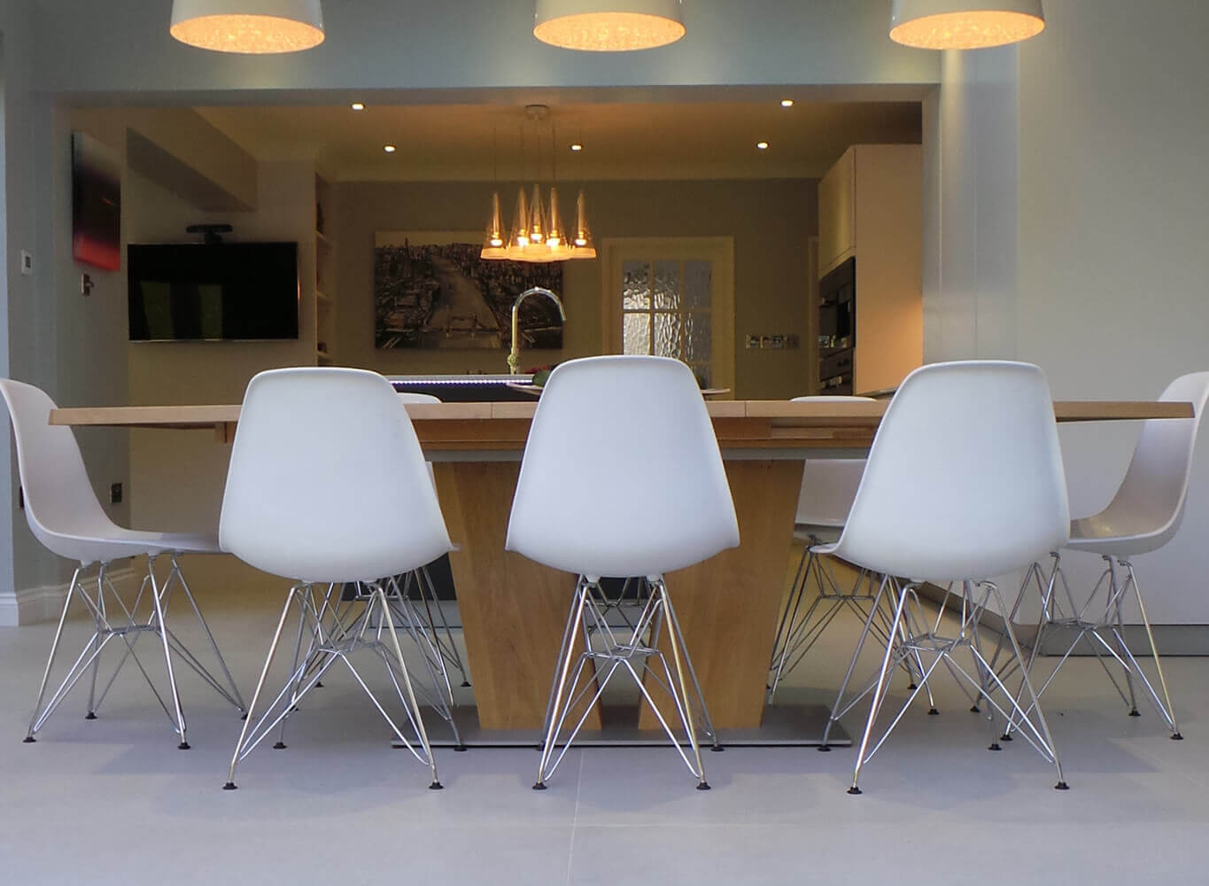 table with white chairs