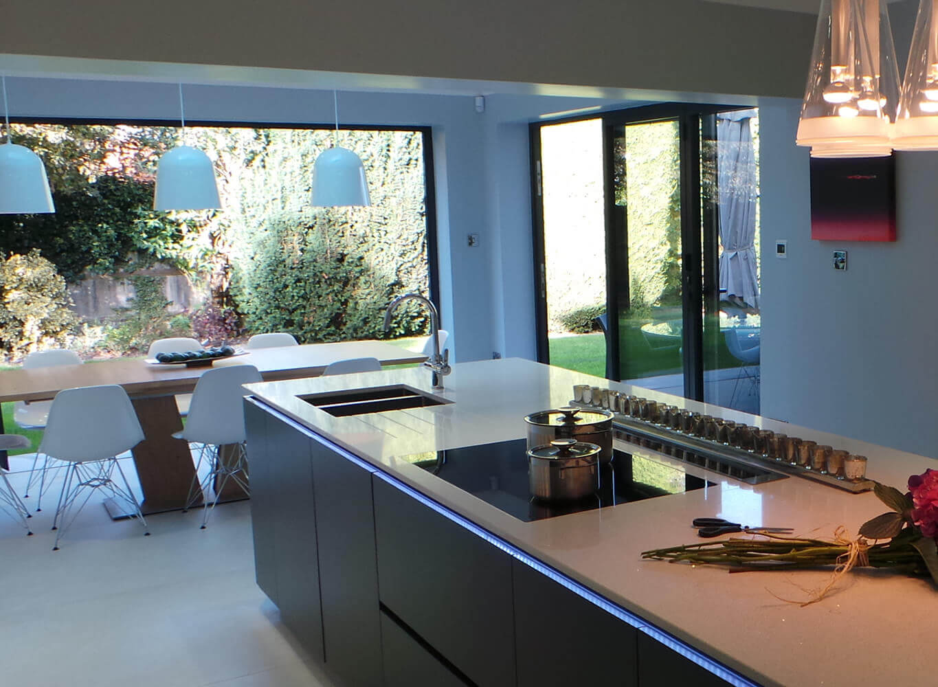 kitchen with an open door into the garden