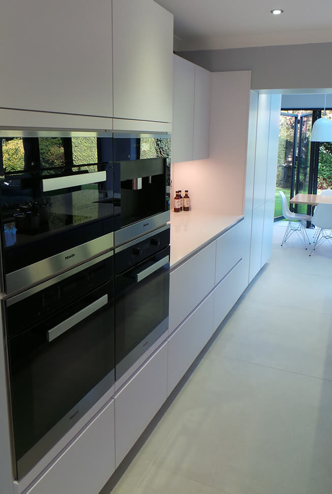 Ovens with shelves by them