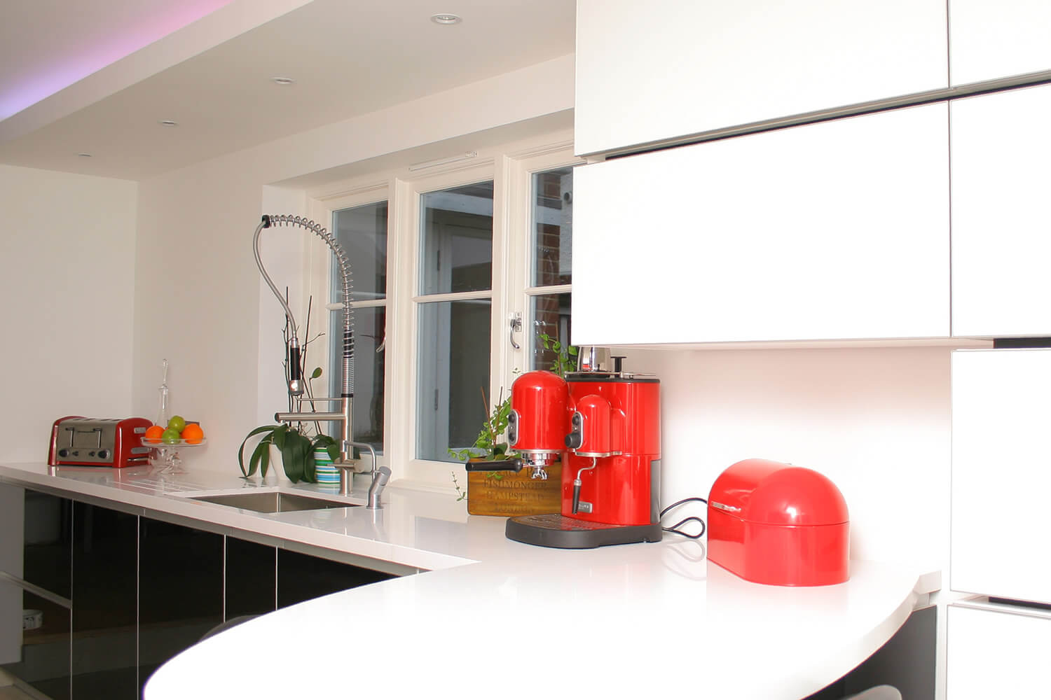 White kitchen with red kitchen electronics